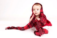 baby in red scarf