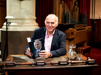 Portrait photo of Vince Cable signing his book in Bath. Beata Cosgrove Photography.jpg
