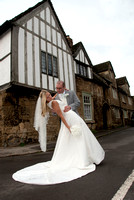bride holding groom on street in Lacock